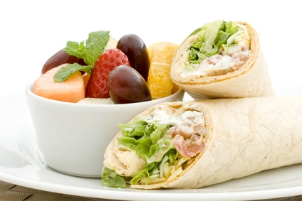 Fruit salad and tortilla wraps for a healthy lunch